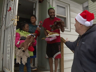 East CLE police help Santa give gifts to kids