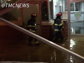 Water gushes out of parking garage at EMC