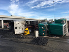 2 overturned semis snarl freeways downtown