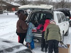 Volunteers brave the winter blast to help others