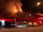 Police help residents from their burning home