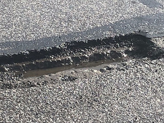 Temporary fix for potholes in Old Brooklyn