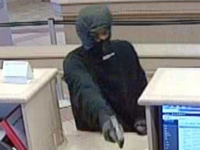 Federal Bureau of Investigation searching for suspects who robbed Dollar Bank in Richmond Heights