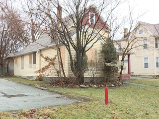 Why is a vacant CMSD-owned home still standing?