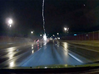 CRAZY VIDEO: Lightning strikes a car on I-90