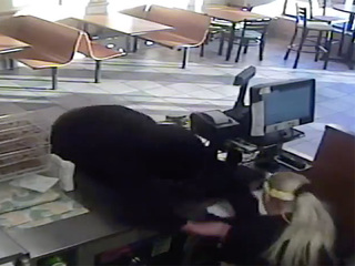 Man dives over counter for cash drawer at Subway