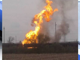 Crews battle train fire at depot in Erie County