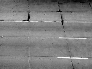 Juvenile hurls asphalt chunk at Canton motorist