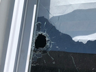 Bullets hit Akron homes during gunfight