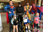 Superheroes wash windows at Akron kids hospital