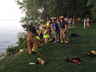 Man rescued after driving lawn mower off cliff