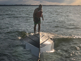 Four rescued after boat capsizes in Lake Erie