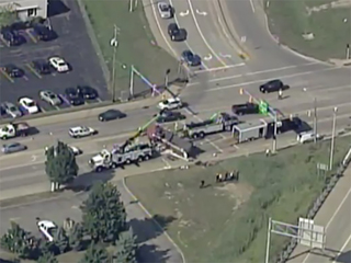 Overturned semi blocks road in Willoughby