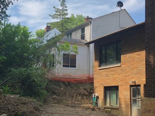 Unfinished work has homes sliding down the block