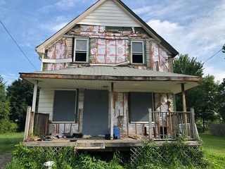 Squatter property condemned but still standing