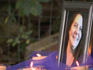 Woman killed, buried in backyard is remembered