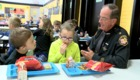 Riverside Schools welcomes officers for lunch