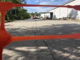 Illegal dumping continues behind former Kmart