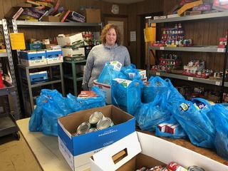 Woman donates shopping spree win to food pantry