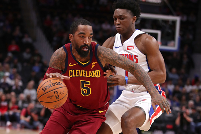 DETROIT, MICHIGAN - NOVEMBER 19 JR Smith 5 of the Cleveland Cavaliers  tries to drive around Stanley Johnson 7 of the Detroit Pistons during the  first ...