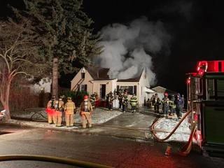 Firefighters battle engulfed home in Bedford