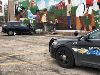 Car slams into building in Cleveland